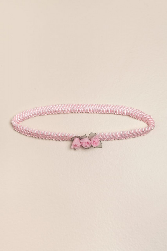 Vincha elastizada con 3 flores rosa